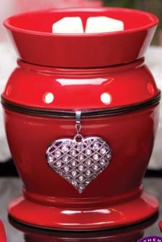 This is a discontinued warmer but I do have one in stock .    Just in time for Valentines day too!
