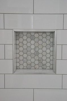 Choosing our shower tile design with subway tile and marble tile niche. This white and gray bathroom features IKEA vanities and herringbone floor. Bathroom Shower Design: Subway Tile and Marble Tile Niche White Subway Tile Bathroom, Subway Tile Showers, Bathroom Floor Tiles, Bathroom Showers, Subway Tiles, Bathroom Sconces, White Tiles, Bathroom Vanities, Shower Niche