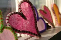 Pipe cleaner and tissue hearts. Shape pipe cleaners, trim one side in glue, place on tissue paper, let dry, then cut around it. How easy is that?
