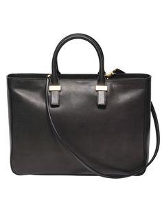 handbags by the row = amazing!