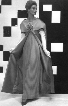 1960 A marriage of stark geometry with femininity in this gown of silk pleats with cape-like mantle by Jules-Francois Crahay for Nina Ricci