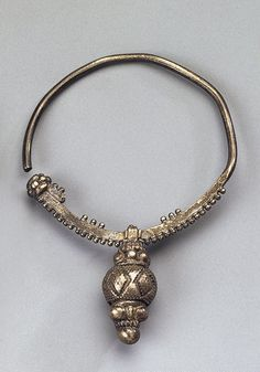 Viking silver crescent earring with beads, stamped, soldered and filigreed. H. 7.8 cm. Culture of Ancient Rus, 10th -11th century. Volyn Province, Dubensky District, the Village of Borshchevka, Russia.