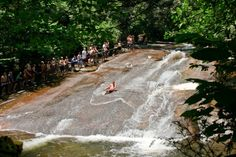 Sliding Rock is even better than it sounds. A naturally-occurring 60-foot waterslide that lands in a seven-foot deep pool. Surrounded by the trees and mountains of Brevard, North Carolina.