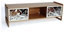 Mixing modern lines with whimsical elements can have beautiful results, as with this media console table. It somehow manages to be classic (with the mid-century modern lines) and unexpected (with the laser-cut metal sculptural doors). So pretty, and you need all the pretty you can get when it comes to hiding your DVR and Wii.