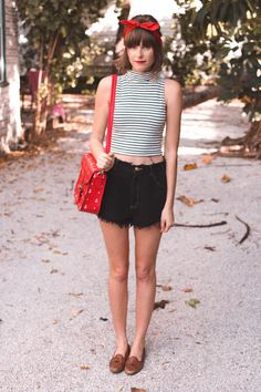 Love this outfit, great contrast. stripes and red. high waisted black shorts, red shoulder bag. summer outfit!