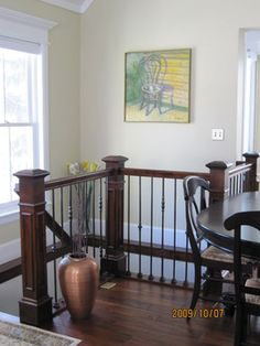 Wrought Iron Stair Railings.  I love this idea for when we finally replace our railings.