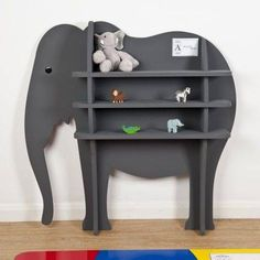shelf over top of elephant shape on wall