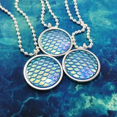 This cute color-shifting mermaid necklace shimmers and sparkles in the light! It is an iridescent sky blue color and a larger version of the petite mermaid scal