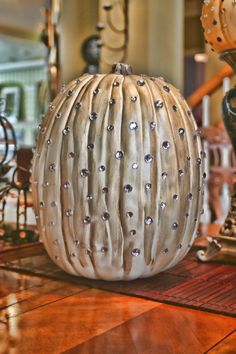 Add some glimmer and shine this fall with these beaded pumpkins. All you need are beautiful faux jewels to create this dazzling Halloween decoration.