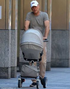 look at that photo of Hollywood A-Lister Bruce Willis pushing his 5-month-old baby's pram. A guy who is hands-on in the care of his baby is the very definition of a hot daddy to us here at Prestige1029.