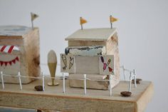 ** This item is currently Reserved ** Chips On The Pier Original one off handmade piece is made from driftwood and reclaimed and recycled materials. It features a seaside pier and a few shops perched on top. With a miniature Fish & Chip shop and Ice Cream stand. Measures 23cm x