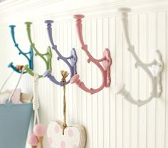 Easily made for the girls from lowes with regular hooks spray painted pretty colors.   Savannah Metal Hooks | Pottery Barn Kids