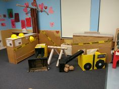 Dramatic play -Construction site. Im a preschool teacher and this month of February we learned about big machines and trucks ...everything is made out of cardboard boxes and children got to help in the painting process (tempera paint) they absolutely loved it!
