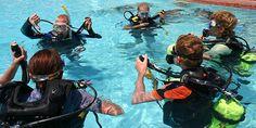 A diving class, showing scuba equipment.