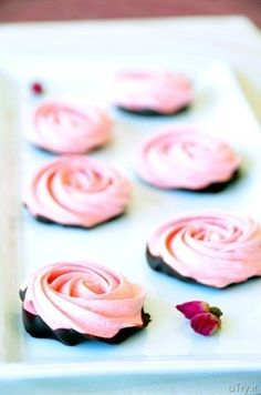 Gorgeous enough for any bridal shower or wedding dessert table: Chocolate-Dipped Strawberry Meringues. #food #strawberry #chocolate #pink #meringues #dessert #wedding