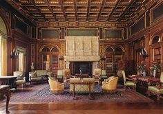 The library at The Breakers.  Has offered ceilings painted with a dolphin, symbolic of the sea and hospitality. The walnut paneling is impressed with gold leaf in the form of a leather-bound book.  Between the ceiling and the gold paneling is green Spanish leather embossed with gold. The fireplace was taken from a 16th century French chateau.