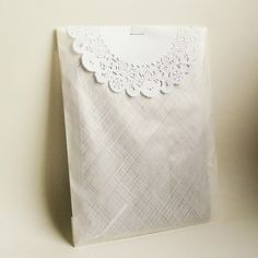 Glassine bag and doilies on Etsy.