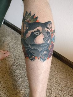 Neo-trad raccoon with berries by Todd Showdown at Heart and Skin in Fort Collins CO
