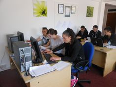 The Group using computers to help in their translations