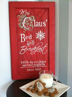 Christmas sign on recycled wood cabinet Door - Mrs Claus' Bed & Breakfast
