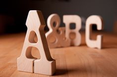 ABC baby Typography Teething Toys natural teether from Little Allouette, hand made in the Columbus Idea Foundry.  Our toys are made of locally sourced hardwoods and, if not left unfinished, are finished only with certified organic flax seed oil.