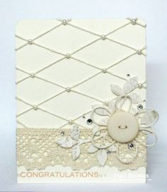 Embossing, pearls and lace.