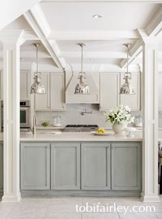 Contemporary and clean kitchen design by Tobi Fairley featuring the Yoke Pendants in Polished Nickel: SL5175-2.
