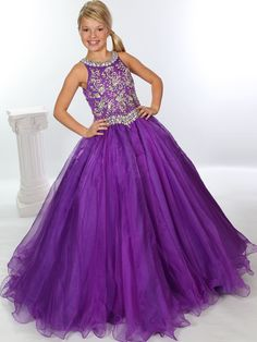 Absolutely amazing girls ball gown created to match the crown! Unique Fashion UF1117F is a gorgeous pageant dress featuring beaded patterns along the fitted bodice which is framed by a scoop high neckline and Basque waist, both embellished with rows of chunky stones. The gathered skirt fall in full to the floor length with ruffles along the hem. We offer the most stunning accessories and pageant shoes to complete this great ensemble.