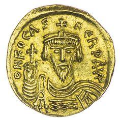 Solidus Gold, Av: DN FOCAS PERP AVC, Büste des Kaisers frontal, Rv: VICTORI_A AVCC, frontal stehender Engel hält Staurogrammstab in der Rechten und Kreuzglobus in der Linken, rechts im Feld N
