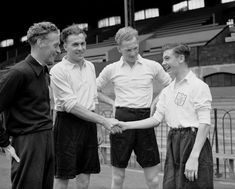 Fulham's new signings meet each other at Craven Cottage in 1950, including a 15-year-old Johnny Haynes, who subsequently had to work as an errand boy in the club offices for two years before he could sign professional papers at the age of 17