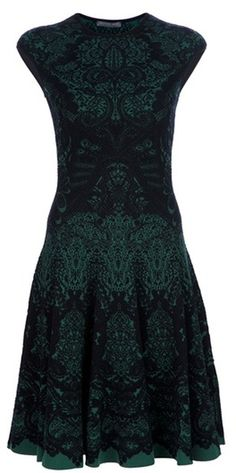 Alexander Mcqueen - Black and green wool blend dress from Alexander McQueen featuring an intricate lace print, a ring neck, peaked sleeves, a fitted waist, a flared skirt and a concealed closure.