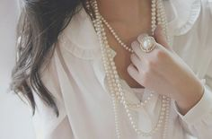 except for the frills and the ring is..a bit too much on top of the layers of pearls - only one or the other..just one is elegant..sometimes..