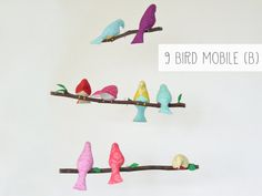 Create the bird mobile of your dreams! Choose whichever colors you would like for your handcrafted bird mobile. Choose from either 9, 7, 6, or 5 birds. Birds will be carefully placed and sewn onto real tree branches with gold, brown, or silver thread. Green felt leaves will decorate each branch. The branches hang with screw eyes and clear fishing line. Mobile will hang with a metal ring that is attached at the top.  This handmade fabric bird mobile is perfect for decorating your nursery or…