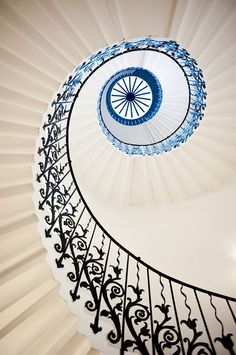 black and white spiral staircase with blue light