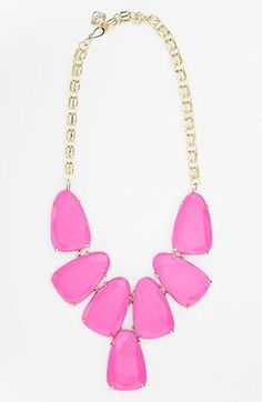 Captivated by this stunning pink statement necklace