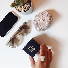 Office essentials: greenery, sunnies, phone, petrock & Ringly! . Thanks for the great desk vibes photo @_kristinramsey! || Shop now at ringly.com.