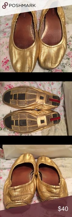 Prada flats! Stunning gold Prada flats! Too big for me but worn anyway! You can see the wear is none, as Prada is the best - imho! Size is 39.5! Priced to sell!  ! These were worn with my green and gold Marc Jacobs top listed separately! Prada Shoes Flats & Loafers