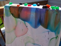 Time for Play  Make colored ice cubes, let them melt on an old sheet, watch colors stretch and blend.  Fun!