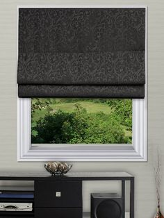 Elspeth Jet Roman Blinds - The Elspeth roman blind range can be made with standard or blackout lining. The blackout lining can only be made with roman blinds with a deluxe headrail system. With the deluxe system you can also have the blind made with a White, Antique, Black or Chrome control chain.