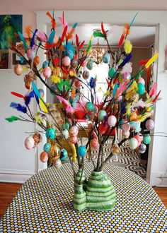 Inspired by the Swedish Easter tradition of paskris (or twigs), this tree showcases brightly colored feathers and bold eggs. As for the base? It's made from an old detergent bottle! Get the tutorial.  - GoodHousekeeping.com