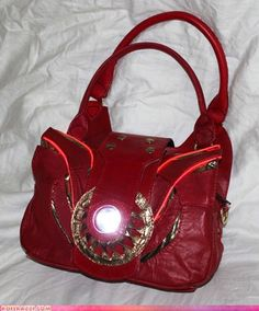 An Iron Man purse with an arc reactor. The very height of nerd fashion, as I'm sure Tony Stark would tell everyone himself. I would so carry this purse EVERYWHERE! Nerd Fashion, Look Fashion, Fandom Fashion, Lolita Fashion, Gothic Fashion, Fashion Boots, Fashion Brand, Fashion Ideas, Jason Wu