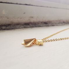 A personal favorite from my Etsy shop https://www.etsy.com/ca/listing/268614980/gold-paper-plane-necklace-with-star-star