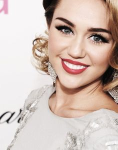 Miley w/ red lips and waves.
