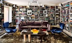 Seating in the library includes a B&B Italia sofa, lounge chairs by Franco Albini and Franca Helg, and African stools from Twentieth. The viscose carpet is by Hamilton Rugs.