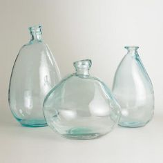 """Another one of my favorite discoveries at WorldMarket.com: Clear Barcelona Vases..these lovely aqua colors will work on our """"Get The Look For Less"""" Case Study #3 beach house book case...Price? $25-$35. each go to designinternationalstaging.com click on my Design Advice Blog then go to Case Study #3 to view the entire project...Linda"""
