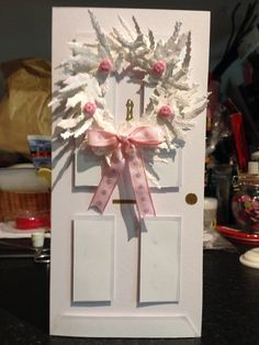 Wreath die by Spellbinders, ribbon, buttons, and bits of peel off.