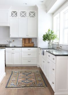 black counter with white cabinets and farmhouse sink|| Studio McGee