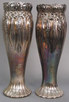 Exceptionally rare Pair of Tiffany silver monumental vases, Art Nouveau repousse having an all over floral design, tops with leaf design continuing to bottom, marked on base Tiffany & Co. Makers 16815 5246.  ht. 23 in.; 247 t oz. - Realized Price: $33,600.00