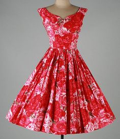 1950's bright red and pink floral party dress with full skirt. No maker label.