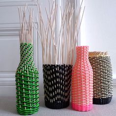 weaving a basket around a bottle